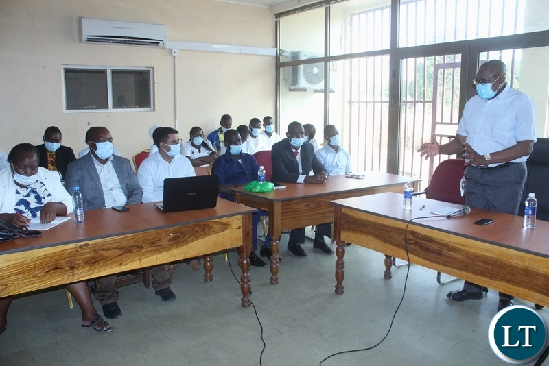 Ministry of Health Technical Services Permanent Secretary Dr. Kennedy Malama (r) addressing health workers at Lewanika General Hospital in Mongu