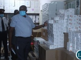 Ministry of Health Technical Services Permanent Secretary Dr. Kennedy Malama (c) impressed with a well-stocked Lewanika General Hospital Pharmacy warehouse during the tour of health facilities in Mongu