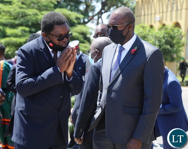 Foreign Affairs Minister Joseph Malanji (left) confers with his Finance Counterpart Minister Dr Bwalya Ngandu during the remembrance day at the National Cenotaph in Lusaka.Picture by SUNDAY BWALYA/ZANIS