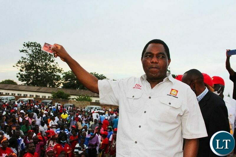 UPND Leader Hakainde Hichilema waves  his voters card at the Party Mobilisation rally in Lusaka