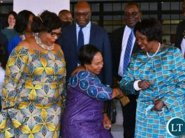 Vice-President Inonge Wina greets Minister of Information, Publicity and information of Zimbabwe, Monica Mutsvangwa during the World Communication Forum -Africa in Lusaka.