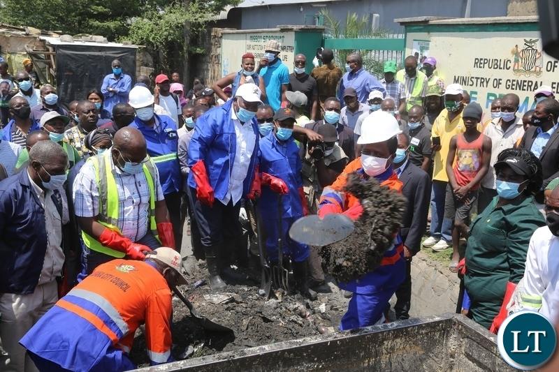President Edgar Lungu at the drainage clean- up exercise in Mandevu Lusaka.