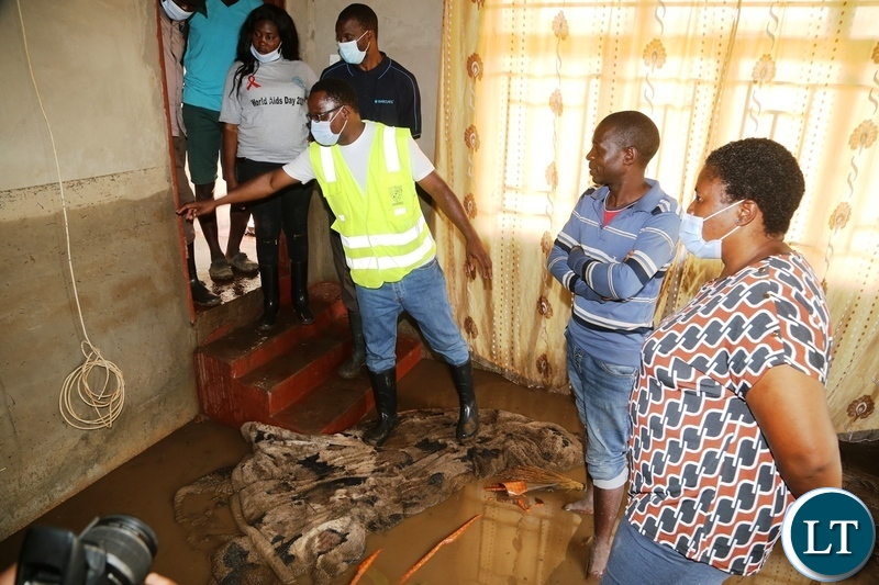 Minister in the Office of the Vice President Olipa Phiri and DMMU national coordinator Chanda Kabwe visiting the flooded homes in Mumbwa District after the Kandesha dam burst it banks yesterday. Sunday, December 27, 2020. Picture by ROYD SIBAJENE/ZANIS