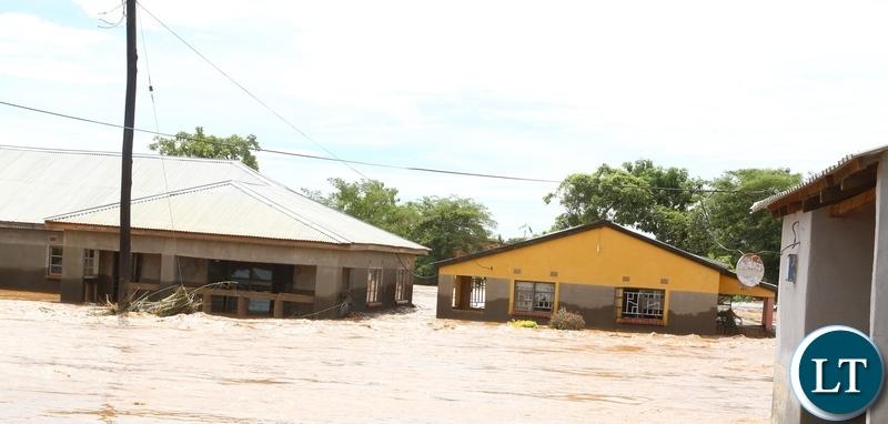 Submerged houses after the Kandesha dam burst it banks causing the flash floods yesterday. Sunday, December 27, 2020. Picture by ROYD SIBAJENE/ZANIS