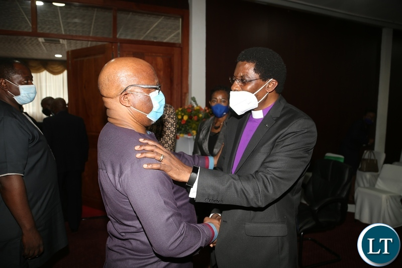 Bishop Joshua Banda confers with former Vice President Nevers Mumba during the commemoration of the declaration of Zambia as a Christian Nation at mulungushi international conference centre yesterday. Tuesday, December 29, 2020. Picture by ROYD SIBAJENE/ZANIS