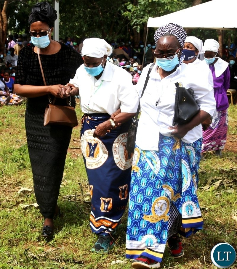 Late Sebastian Zulu's Widow Nyondo (middle) being led to take a seat during burial of her late Husband in Petauke's Kakwiya village. Picture by SUNDAY BWALYA /ZANIS