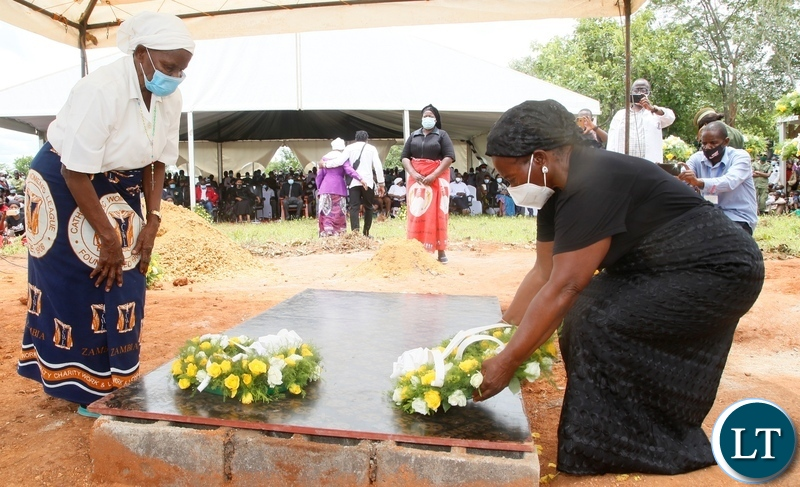 Late Sebastian Zulu's Widows lay wreaths at the grave of their late husband during burial in Petauke's Kakwiya village. Picture by SUNDAY BWALYA/ ZANIS